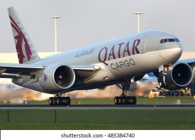 SCHIPHOL, AMSTERDAM, NETHERLANDS - APRIL 4, 2016: Boeing 777-FDZ A7-BFE of Qatar Airways Cargo taking off at Schiphol international airport.