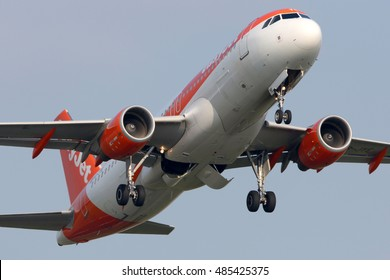 SCHIPHOL, AMSTERDAM, NETHERLANDS - APRIL 4, 2016: Airbus A320-214 HB-JYE of EasyJet airlines taking off at Schiphol international airport.