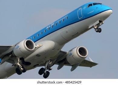 SCHIPHOL, AMSTERDAM, NETHERLANDS - APRIL 4, 2016: Embraer ERJ-190STD PH-EZX of KLM Cityhopper airlines taking off at Schiphol international airport.
