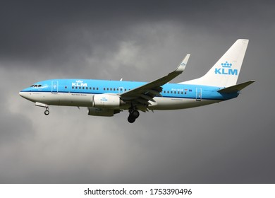 SCHIPHOL, THE NETHERLANDS - AUGUST 18, 2013: Dutch KLM Boeing 737-700 with registration PH-BGE on short final for Amsterdam Airport Schiphol.