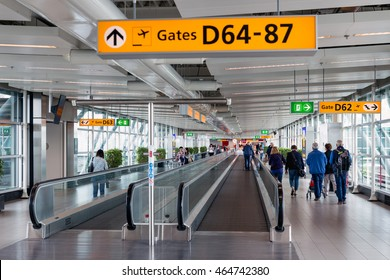 SCHIPHOL, THE NETHERLANDS - MAY 16, Travellers walking to the gate on May 16, 2016 at Schiphol Airport, The Netherlands