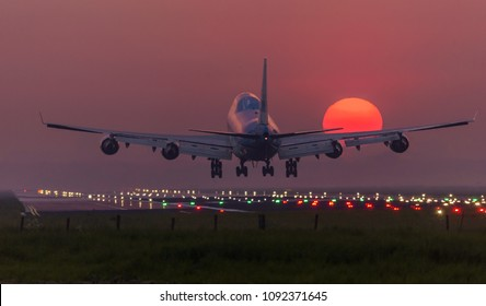 Schiphol, N-H/Netherlands -May 09-05-18- Airplane from KLM Royal Dutch Airlines Boeing 747. Is landing on the runway during a beautiful bright sunrise at the airport.