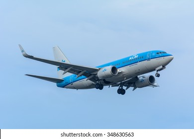 Schiphol, Noord-Holland/Netherlands- December 07-12-2015 -Plane from KLM Royal Dutch Airlines PH-BGG Boeing 737-700 preparing for landing at the airport. Airplanes are flown by pilot of the aircraft