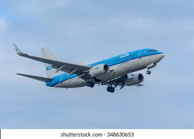 Schiphol, Noord-Holland/Netherlands- December 07-12-2015 -Plane from KLM Royal Dutch Airlines PH-BGK Boeing 737-700 is preparing for landing at the airport. Airplanes are flown by a pilot.
