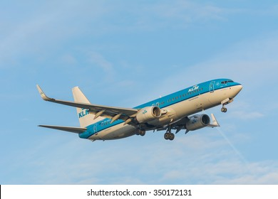 Schiphol, Noord-Holland/Netherlands- December 07-12-2015 -Plane from KLM Royal Dutch Airlines PH-BXC Boeing 737-800 is preparing for landing at the airport. Nice aviation background.
