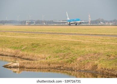 Schiphol, Noord-Holland/Netherlands- December 19-12-2016 -Plane KLM Royal Dutch Airlines PH-BXB Boeing 737-800 started landed at Schiphol Airport. Taken during daylight, typical aviation background.