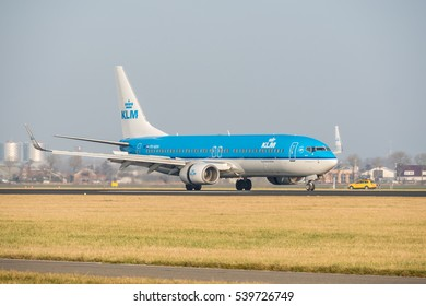 Schiphol, Noord-Holland/Netherlands- December 19-12-2016 -Plane KLM Royal Dutch Airlines PH-BXH Boeing 737-800 started landed at Schiphol Airport. Taken during daylight, typical aviation background.