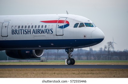 Schiphol, Noord-Holland/Netherlands- februari 04-03-2017 -Plane from British Airways is landing on Schiphol airport on a cloudy day. International airplane close up picture.