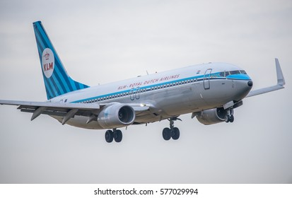 Schiphol, Noord-Holland/Netherlands- februari 04-03-2017 -Plane from KLM Royal dutch Airlines is landing on Schiphol airport on a cloudy day. International airplane close up picture.