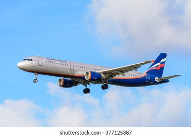 Schiphol, Noord-Holland/Netherlands -February 11-02-2016 -Plane from Aeroflot Russian Airlines VP-BOC Airbus A321-200 is landing at Schiphol airport. Blue cloudy sky at the background of the airplane.