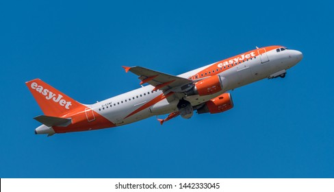 Schiphol, Noord-Holland/Netherlands - Jul 02-07-2019 - Commercial airplane from EasyJet, G-EZWF, Airbus A320-200 is leaving Schiphol airport. The plane is flying to the next destination.