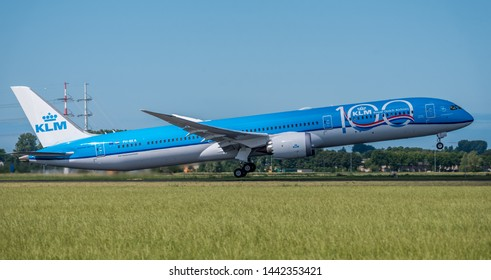 Schiphol, Noord-Holland/Netherlands - Jul 02-07-2019 - Commercial airplane from KLM Royal, BOEING 787-10- 100 years anniversary is leaving Schiphol airport. The plane is flying to the next destination
