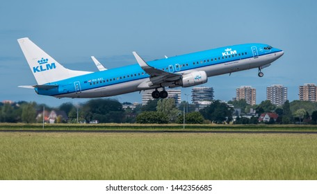 Schiphol, Noord-Holland/Netherlands - Jul 02-07-2019 - Commercial airplane from KLM Royal Dutch Airlines PH-BXL, Boeing 737-800 is leaving Schiphol airport. The plane is flying to the next destination