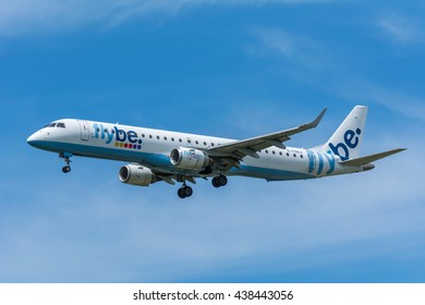 Schiphol, Noord-Holland/Netherlands - June 16-06-2016 - Airplane Flybe G-FBJH Embraer ERJ-175 is flying to the airport runway. The Commercial jet aeroplane started the landing gear system for landing.