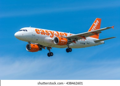 Schiphol, Noord-Holland/Netherlands - June 16-06-2016 - Airplane easyJet G-EZDIAirbus A319-100 flying to the airport runway. The Commercial jet aeroplane started the landing gear system for landing.