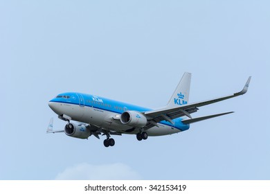 Schiphol, Noord-Holland/Netherlands- November 20-11-2015 -Plane from KLM Royal Dutch Airlines PH-BGG Boeing 737-700 is landing at Schiphol Airport. Photo taken during a dark cloudy autumn day.