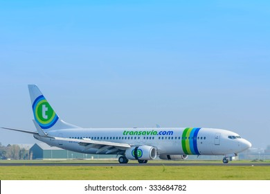 Schiphol, Noord-Holland/Netherlands- September 18-09-2015 -Plane from Transavia PH-HZX	Boeing 737-800 is started landed at Schiphol Airport. Photo taken during daylight, typical aviation background.