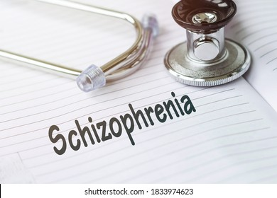 SCHIZOPHRENIA and psychotic concept schizophrenia. Text on a medical card next to a pen stethoscope.Mental or schizophrenia treatment. Concept photo for psychiatry