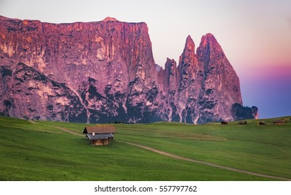 Schlern mountain with alpine hut, Seiser Alm, South Tyrol, Italy