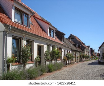 Schleswig, Germany - July 19, 2012: Street in Holm (old fisherman's quarter in Schleswig) with authentic 18th century houses. Popular tourist destination in Schleswig-Holstein, North-West Germany
