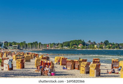 Eckernförde, Schleswig Holstein / Germany — 05.24.2018: People resting on a beach by the Eckernförde Bay (part of Baltic Sea).
