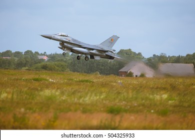 Schleswig - Jagel, Germany - June 19, 2014:Belgium - Air Force General Dynamics F-16 Fighting Falcon board number FA-109 is takeoff for background of field and skyline from Jagel during NTM2014