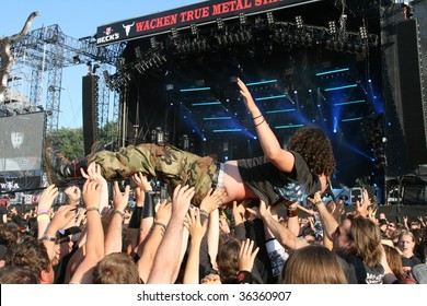SCHLESWIG-HOLSTEIN, GERMANY - JULY 31: Crowd of people and stage diving at Wacken Open Air, world's largest open air heavy metal music festival on July 31, 2009, in Schleswig-Holstein, Germany