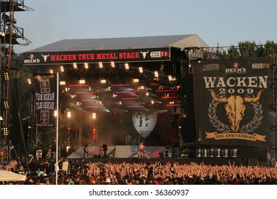 SCHLESWIG-HOLSTEIN, GERMANY - JULY 31: Crowd of people at Wacken Open Air, world's largest open air heavy metal music festival on July 31st, 2009, in Schleswig-Holstein, Germany