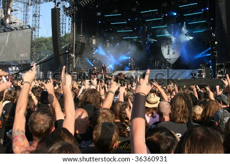 SCHLESWIG-HOLSTEIN, GERMANY - JULY 31: Crowd of people at Wacken Open Air, world's largest open air heavy metal music festival on July 31, 2009, in Schleswig-Holstein, Germany