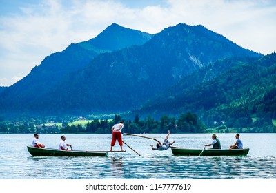 Schliersee, Germany - July 28: Bavarian competition of two groups with rowboats at a summer festival called Fishermen Joust in Schliersee, germany on July 28, 2018