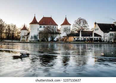 Schloss und Park Nymphenburg at winter time in Munich, Germany.