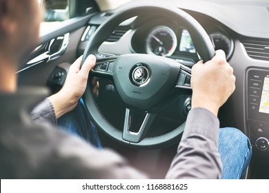 "Schmidgaden, Germany - August 30 2018: Driver holding steering while in ""Skoda Octavia"" car"