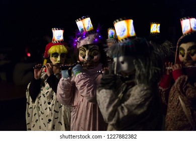 Schneidergasse, Basel, Switzerland - February 19th, 2018. Closeup of carnival participants wearing individual costumes with illuminated mask lanterns.