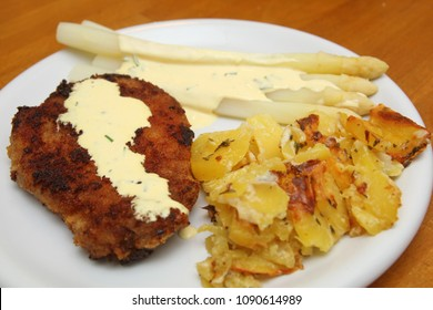 Schnitzel with asparagus and potato gratin