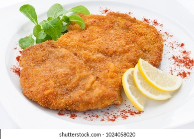Schnitzel with lemon and greens