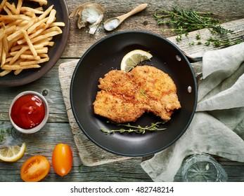 schnitzel on cooking pan, top view