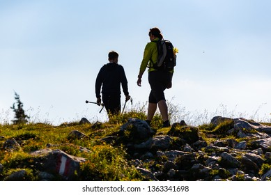 Schockl, Styria, Austria - 07.07.2018: A couple hiking over mountain in Austria Styria.Shockl a tourist and hiking destination.