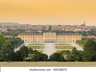 Schoenbrunn (Schonbrunn) imperial palace historical building panorama in Vienna, Austria, Europe during summer day sunset. Panoramic view to Wien skyline