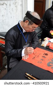 """A scholar writes Chinese calligraphy characters at Temple of Literature in Hanoi, Vietnam on Apr 22,2016. """"Calligraphy giving"""" is a popular tradition during Tet or festival   to Vietnamese people."""