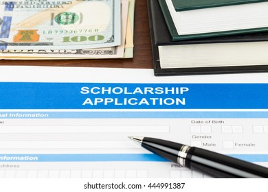 Scholarship application form with pen, dollar banknote and text book