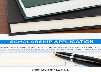 Scholarship application form with pen and text book; the document is mocked-up