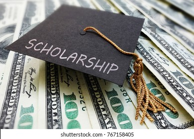 Scholarship graduation cap on money