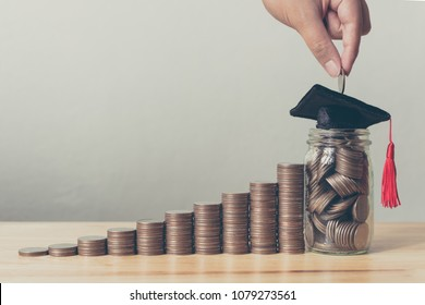 Scholarship money concept. Hand of male or female putting coins in jar with money stack step growing growth saving money investment