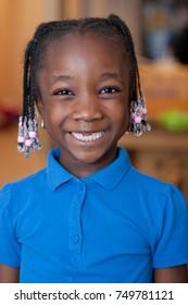 School age black girl missing 2 front teeth