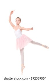 school age girl playing dress up wearing a ballet tutu, isolated on white
