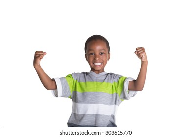 School aged child showing off his muscles