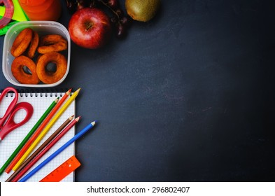 School background with school lunch, pencils and a notebook. the toning. selective focus