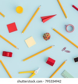 School background with sticky note, pen, ruller paper clip, paper plane etc. Flat lay.