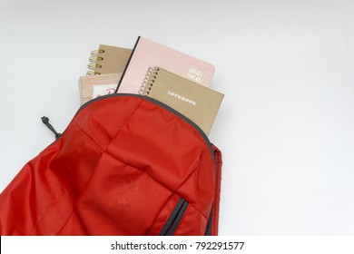"school bag with book ""notebook and travel time"" on white background"