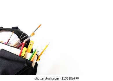School bag and education equipment with cropped shot on white screen, Black to school concept and copy space.